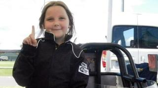 Handout photo from Junior Dragster Australia taken on October 14, 2017 shows eight-year-old Anita Board next to her junior dragster racing car.