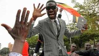 Robert Kyagulani, commonly known as Bobi Wine waves to his supporters moments after being sworn in as a Ugandan Member of Parliament on 11 July 2017.