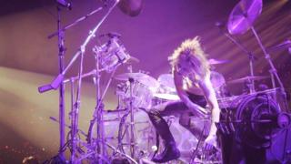 Yoshiki behind his drum kit