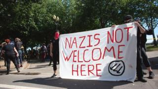 """Antifa protesters with a """"Nazis not welcome here"""" banner"""