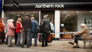 Customers queuing outside a Northern Rock branch to remove their money