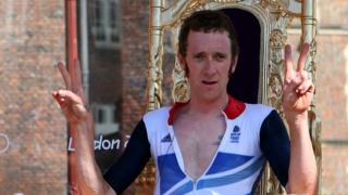 """Bradley Wiggins celebrates after winning gold in the Men""""s Individual Time Trial Road Cycling at the London 2012 Olympic Games"""