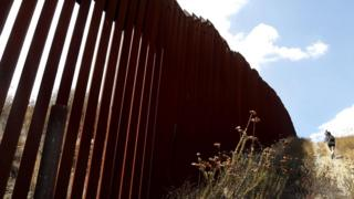 The border wall that bisects Tecate, Mexico and Tecate, California