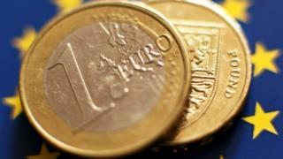 A pound and a euro on the EU flag
