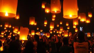 People fly lanterns at Borobudur temple during New Year celebrations in Magelang, Indonesia, January 1, 2018 in this photo taken by Antara Foto.
