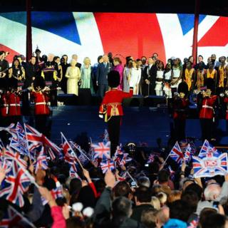 Queen Elizabeth II on stage outside Buckingham Palace in London with Charles, Camilla and a host of pop stars at the Diamond Jubilee concert during celebrations to mark her 60 years as sovereign.