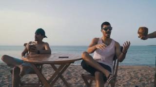 Omani entertainer Hanood relaxes on a beach