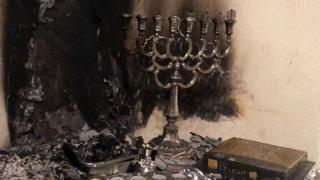 hanukkah candle in burnt room