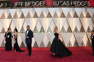 Terrence Howard (centre left) and Kirsten Dunst arrive at the Oscars