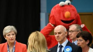 Theresa May and Elmo