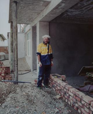 A man stands on a building site