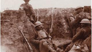 Soldiers of the Royal Welch Fusiliers pose for a photograph in their trench