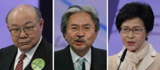 This combination of three file photos taken Tuesday, 14 March 2017, shows Hong Kong chief executive candidates, from left, former judge Woo Kwok-hing, former Financial Secretary John Tsang and former chief secretary Carrie Lam, speaking during a chief executive election debate in Hong Kong