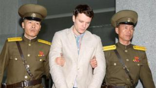 Otto Warmbier with North Korea police (16 March 2016)