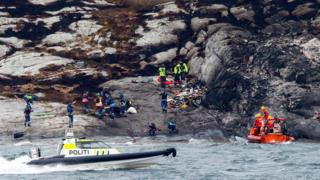 Police and rescue workers investigate at the scene following the Friday 29 April helicopter crash on the coast of Norway near Bergen, on Sunday 1 May 2016