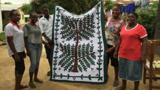 Quageh quilting group in Caldwell, Liberia, recreate Martha Ricks' Coffee Tree quilt