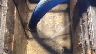 NI Water crews are clearing the sewer by using hoses and spades to break up the fatberg