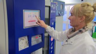 Nurse Carmel Wright using blood vending machine