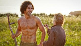 Aidan Turner with make-up woman on the set of Poldark