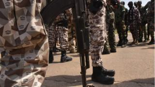 Ivory Coast soldiers standing guard at the airport in Bouake