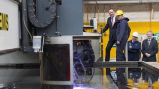 Tony Douglas CEO of Defence Equipment and Support commences the steel cut