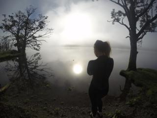 Woman about to swim in misty loch