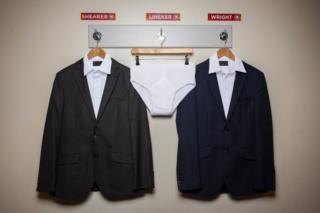 Promo pic of Gary Lineker's pants between two suits