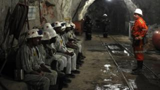 Miners attend a security briefing on October 10, 2013 at the Cullinan Diamond Mine, north-east of Johannesburg.
