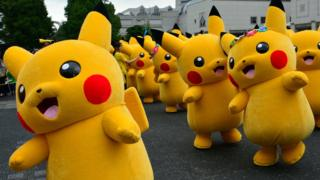 Dozens of Pikachu characters parade at the Landmark Plaza shopping mall in Yokohama