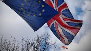 UK and EU flags flying