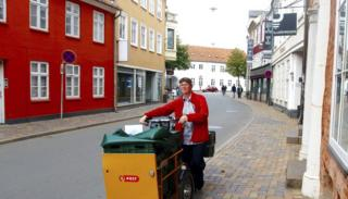 A Danish postal worker delivering in Copenhagen