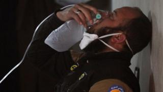 Civil defence volunteer, using an oxygen mask, after a suspected gas attack in the town of Khan Sheikhoun, Idlib, 4 Apr 2017