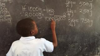 Child at blackboard