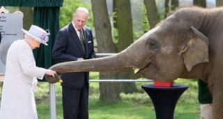 Queen Elizabeth II and Prince Philip, Duke of Edinburgh feed Donna, an Asian Elephant