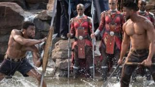 Two shirtless males stare at each other in the middle of a fight taken from Marvel's Black Panther