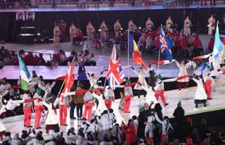 Flag bearers walk through the stadium at the closing ceremony