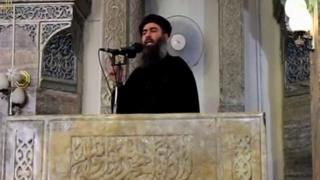 A man purported to be the reclusive leader of the militant Islamic State Abu Bakr al-Baghdadi making what would have been his first public appearance, at a mosque in the centre of Iraq's second city, Mosul, according to a video recording posted on the Internet on July 5, 2014, in this still image taken from video.