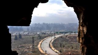 Syrian forces stand guard near evacuation (16 Dec)