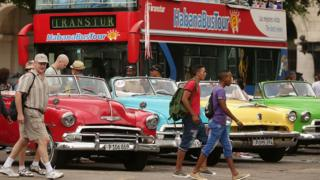 Tourists and vintage American cars in old Havana, 2015