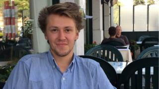 David Hyde, a UN intern from New Zealand, sitting at a Geneva cafe - August 2015