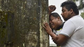 Relatives and friends of Deisy Rosero, 26, mourn during her funeral at a cemetery in Mocoa, Putumayo department, southern Colombia