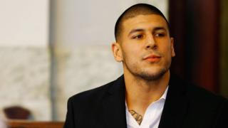 Aaron Hernandez sits in the courtroom of the Attleboro District Court in Massachusetts in 2013.