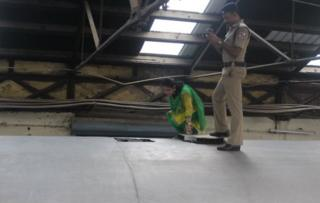 Indian police personnel stand guard alongside the Salem-Chennai Express train, which was robbed while in transit, at Egmore Railway station in Chennai on August 9, 2016. Some 50,000,000 INR, equivilent to approximately 749,000 USD, has been stolen from a moving train as it was being transported to the Reserve Bank of India, police said.
