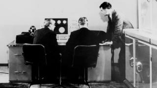 Alan Turing (right) and colleagues working on the Ferranti Mark I Computer, 1951