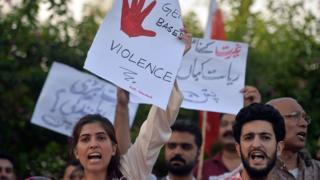 Pakistani civil society activists carry placards during a protest in Islamabad on July 18, 2016 against the murder of social media celebrity Qandeel Baloch by her own brother