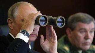 Russian President Vladimir Putin (L), accompanied by Chief of the General Staff Valery Gerasimov, watches the joint Belarus-Russian Zapad-2017 military exercises
