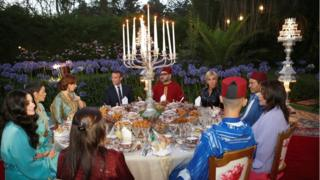 "Morocco""s King Mohammed VI (CR), his wife Princess Lalla Salma (background L), France""s President Emmanuel Macron (CL) and his wife Brigitte Trogneux (background R), attend an Iftar meal, the evening meal when Muslims end their daily Ramadan fast at sunset, at the King Palace in Rabat, Morocco, June 14, 2017"