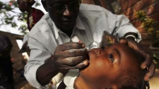 Boy being vaccinated against polio