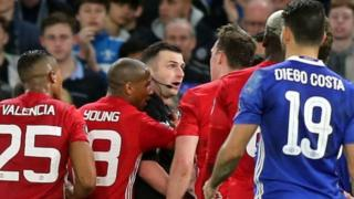 Referee Michael Oliver was surrounded by several Manchester United players after sending off midfielder Ander Herrera