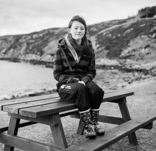 A girl sits on a bench